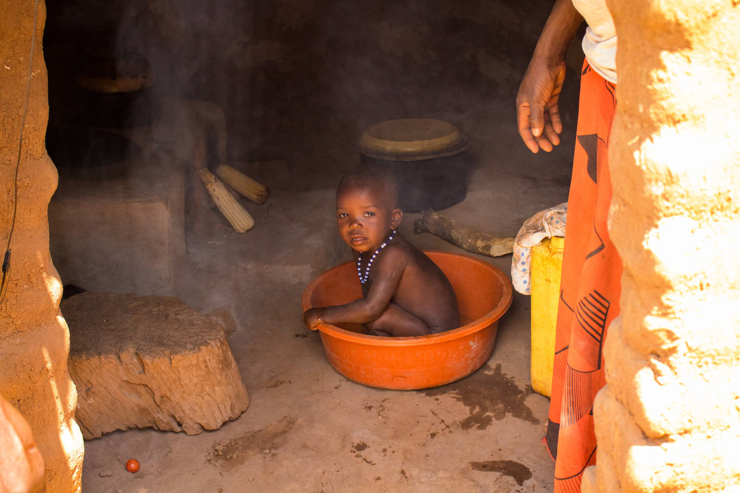 Young children are often in the kitchen with their mothers, since women spend many hours a day preparing food. Open-cooking fires are especially dangerous to children, since children can trip on logs, causing hot pots to spill on them, and smoke-inhalation can damage their lungs.
