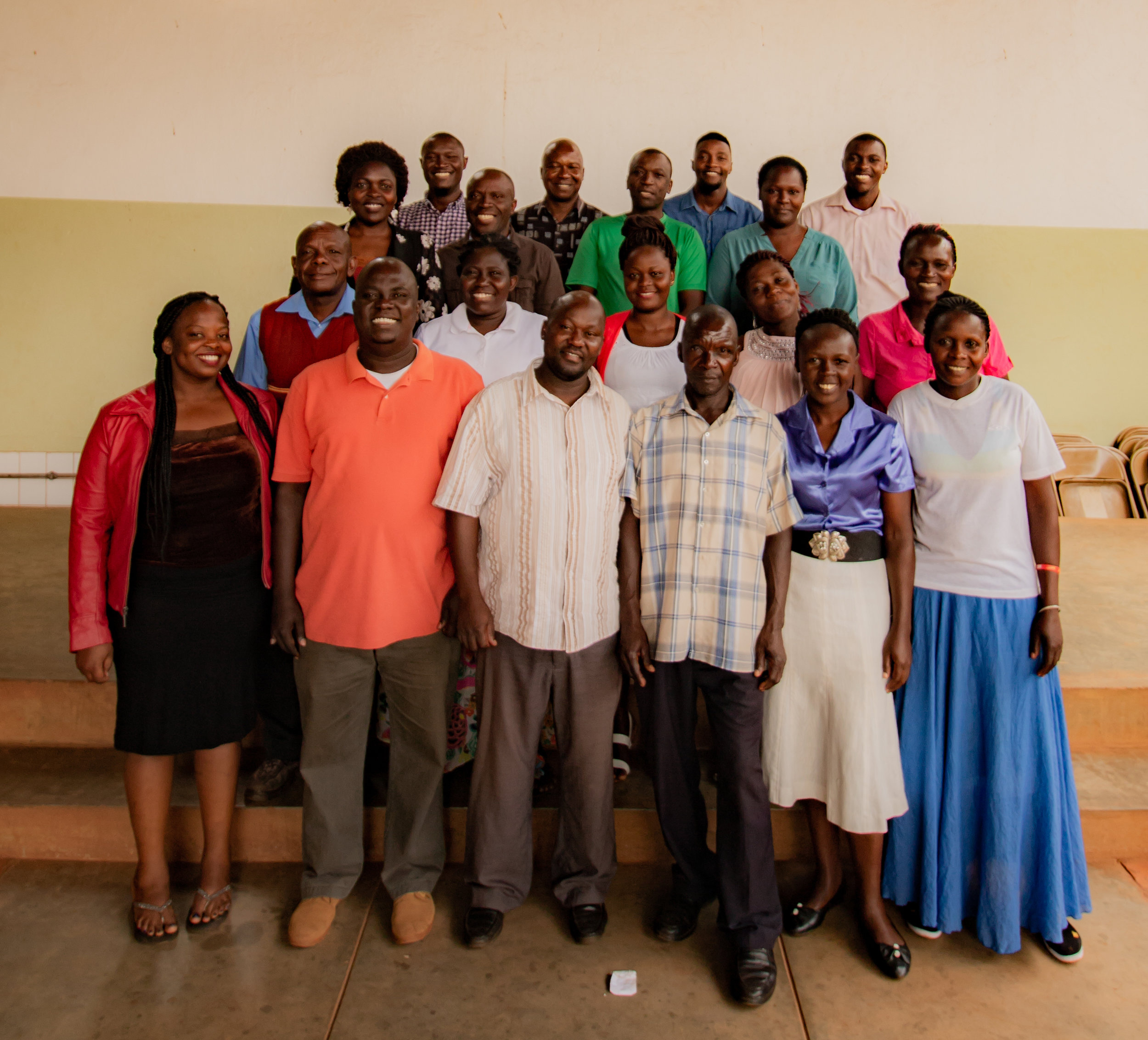 Top row:   Tom Ngobi ,  Roy Mwesigwa ,  Enock Madoolo , and  Alex Walyomu .  Second row:   Justine Nandera ,  Steven Kambale ,  Abraham Mulongo , and  Suzan Keddi .  Third row:   Alex Bamulumbye ,  Ida Bazonona ,  Sarah Naguti ,  Manuela Ongyera , and  Jeska Nairuba .  Bottom row:   Lorna Katagara ,  Henry Oyier ,  David Balimunsi ,  Martin Kibuuka ,  Harriet Kefeza , and  Tape Bwana .  Not pictured:   Irene Ngobi .