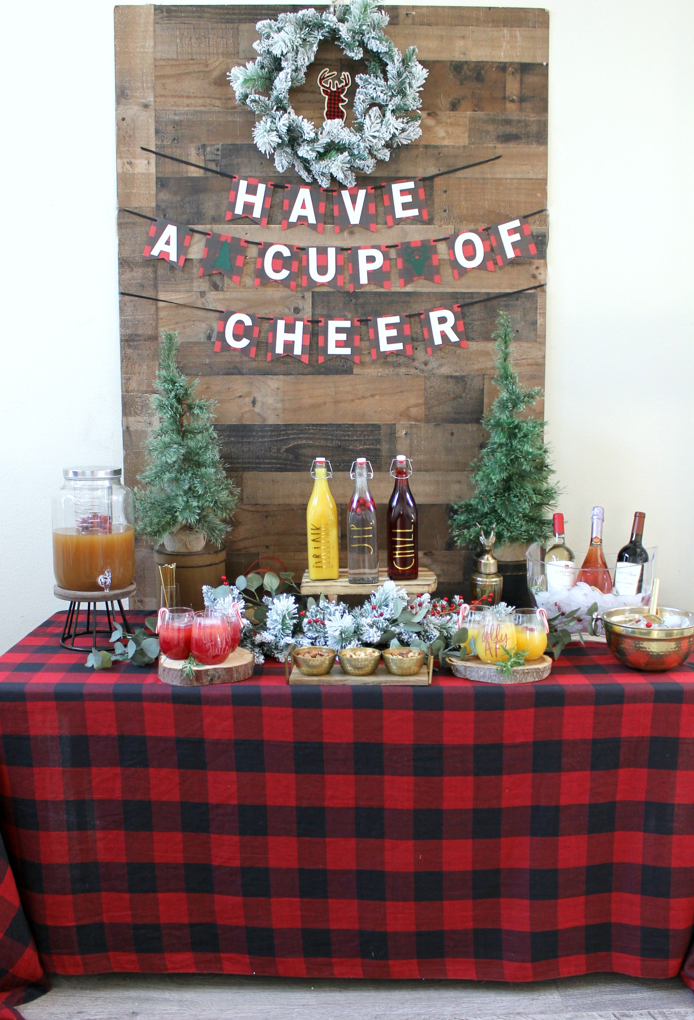 Holiday Drink table ideas-christmas party-rustic christmas-buffalo plaid party-chrsitmas party ideas-christmas party decor-christmas drink station-christmas drink style-www.sugarpartiesla.com