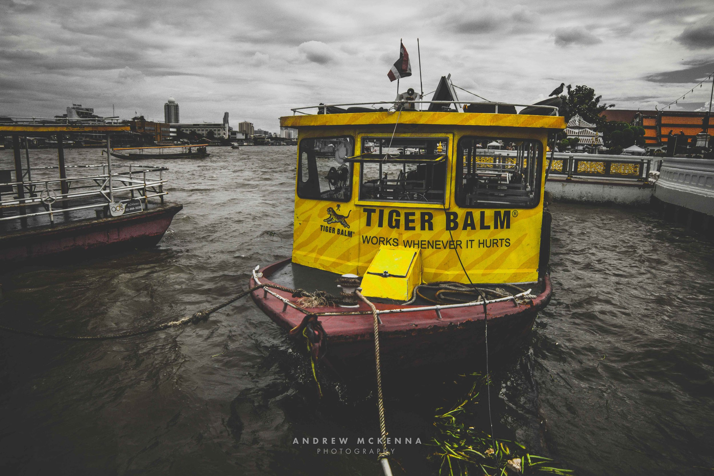 Wat Arun Temple Bangkok. Thailand, Photography by Andrew McKenna. tiger Balm Boat.