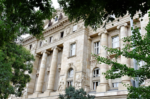 Image source for this photo of the National Bank of Hungary above (Wikimedia).