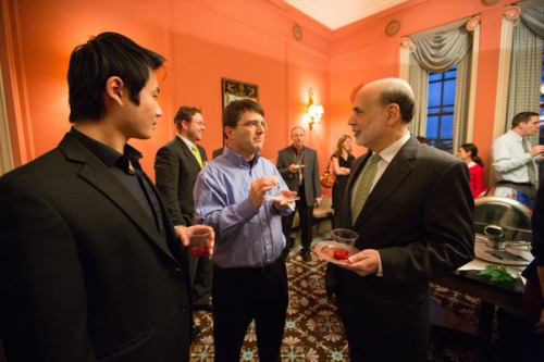 Photo of Miles telling Yang Liu and Ben Bernanke how good the hors d'oeuvres are  and how to eliminate the zero lower bound when  Ben Bernanke came to give a talk at the University of Michigan  on January 14, 2013
