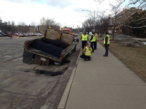 """""""Welcome to Michigan. Where the pothole filling crews get stuck in potholes…"""""""