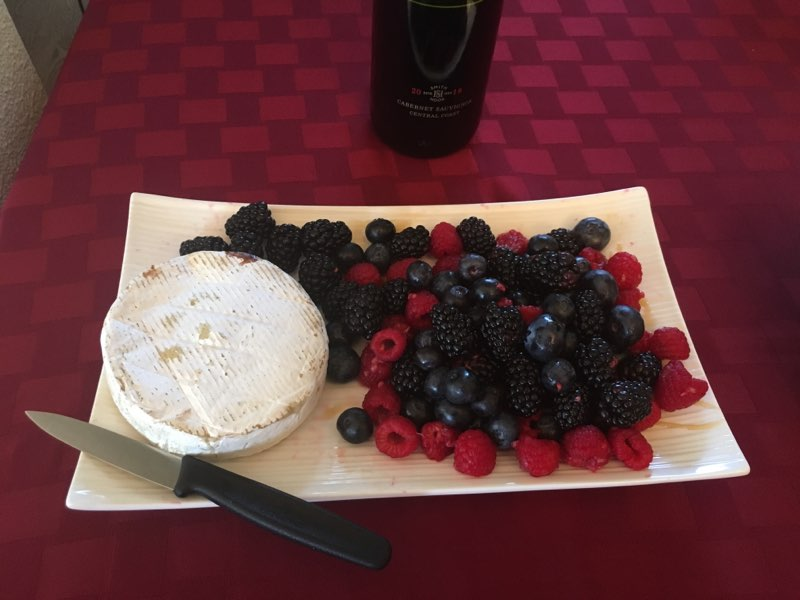 Blueberries, raspberries, blackberries and Camembert cheese