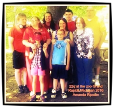 I am in the black top Bella is in the one in the red 22q hat and Adam hubby is in yellow. We are standing with friends for a picture from last years 22q at the zoo in Grand Rapids Michigan we had a small but mighty group spreading awareness