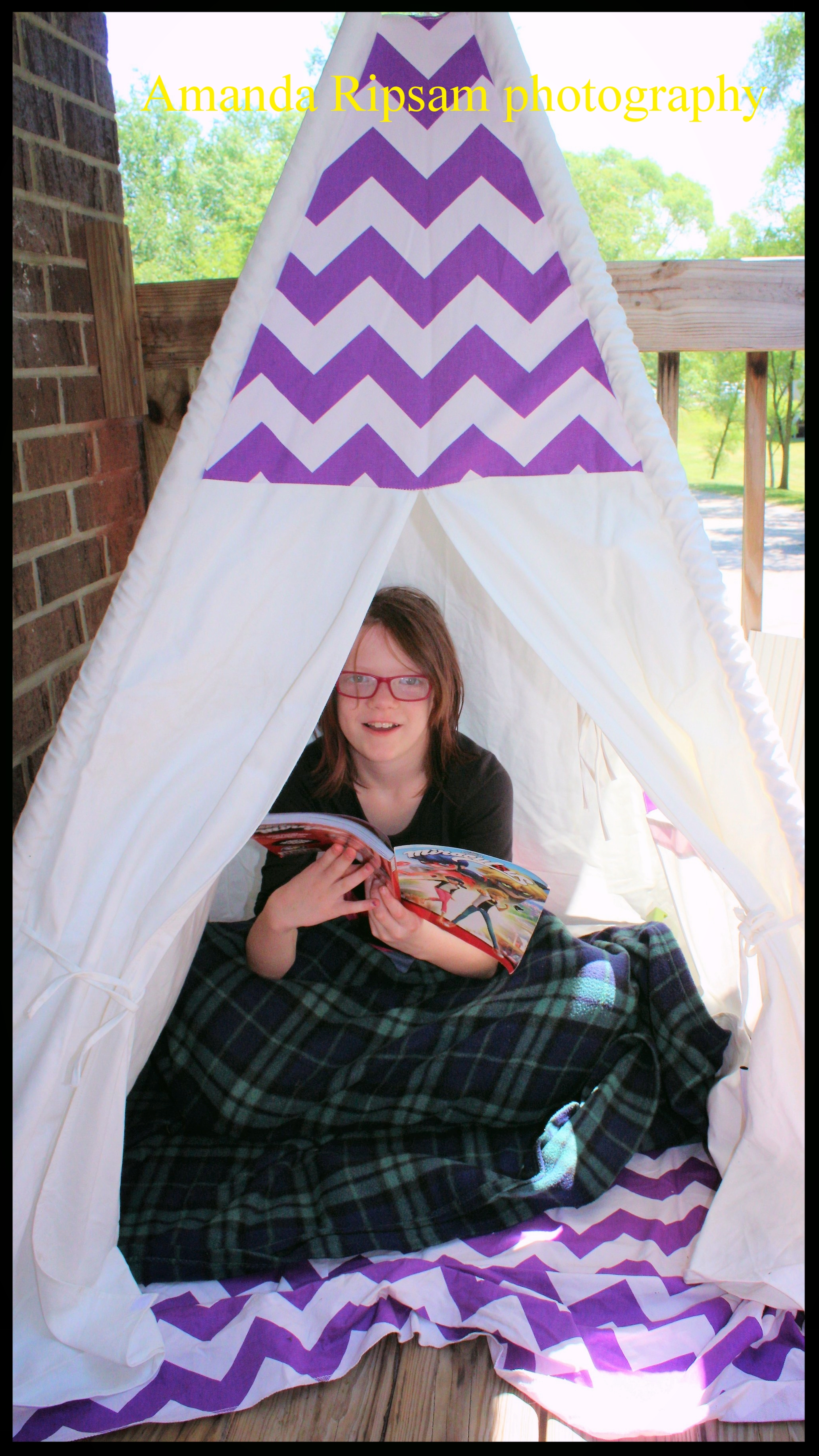 Bella enjoying her new teepee encourages summer reading. Even if it is comic books