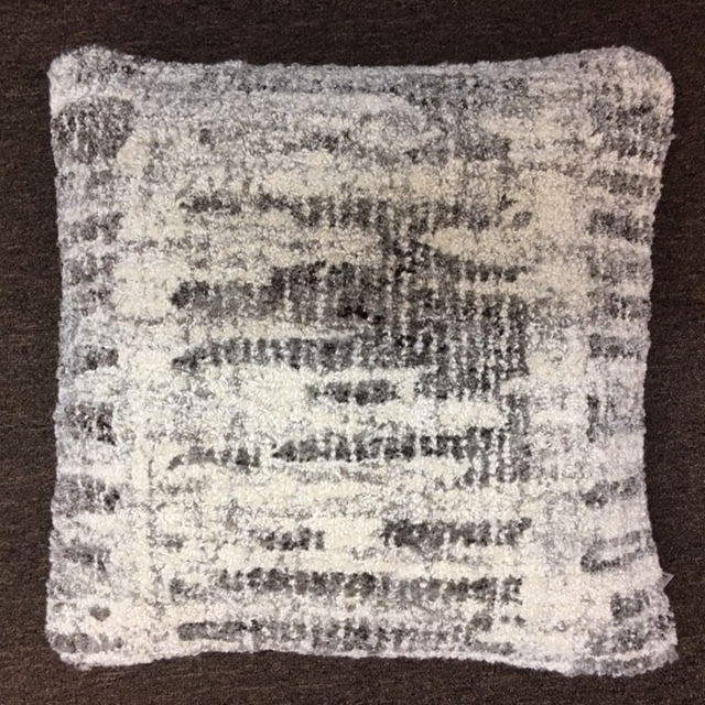 "20""x 20"" Wool blend pillow with down insert.  $142."