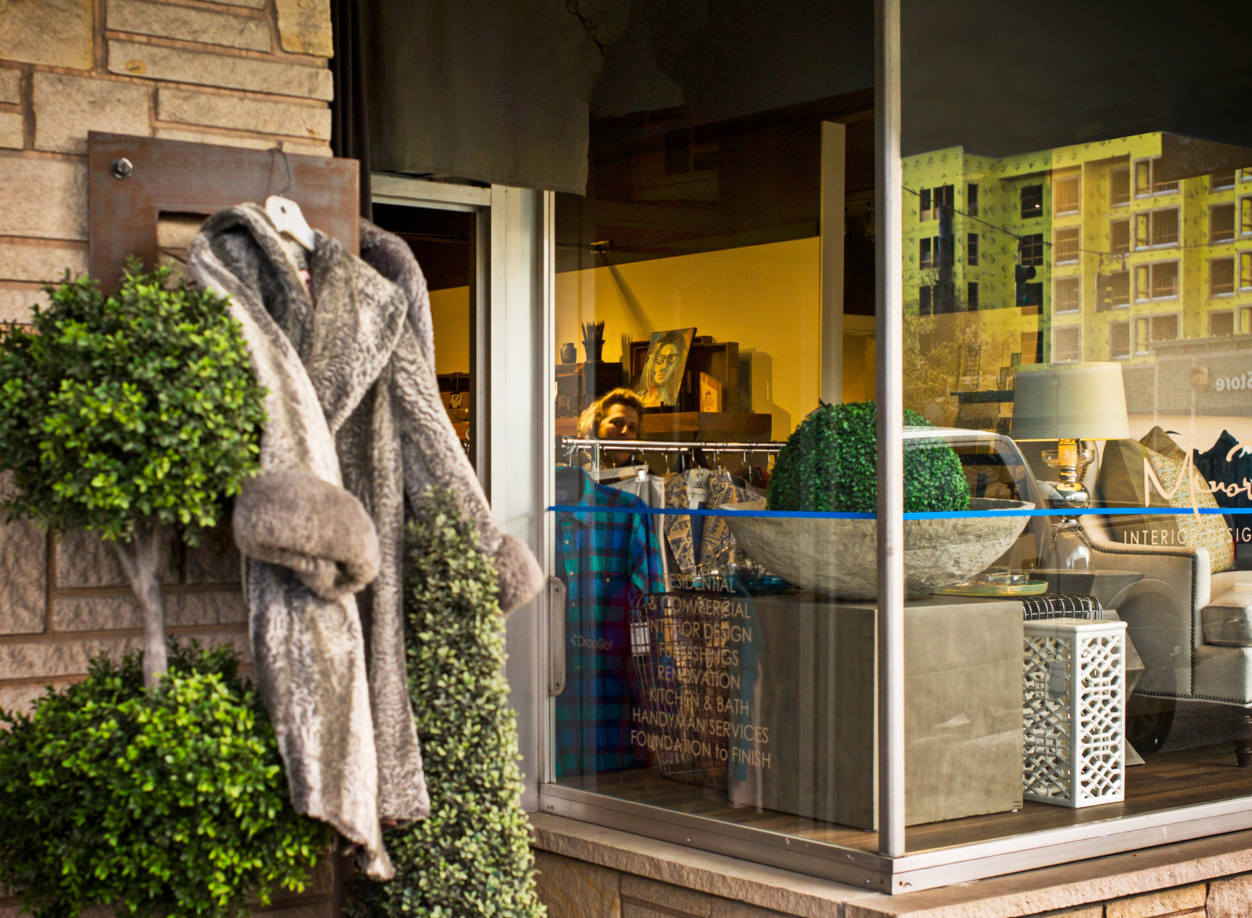 Woman In Shop With Coats Hanging On The Sign In Front, On Proctor ©Christopher Petrich