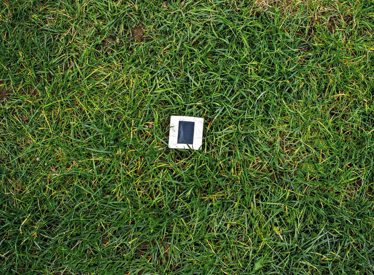 Discarded Slide On The Grass - What One Saw Today ©Christopher Petrich 14x17 Matted in Museum Rag White Board. Printed to Hahnemuhle PhotoRag.