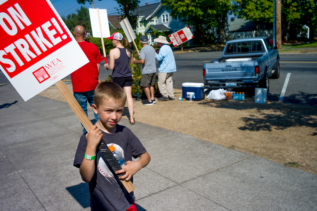 Walking The Line On Strike. A boy on the line September 7, supporting wage Increases for Tacoma teachers, whose net increase would amount to six tenths of a percent, barely over a half penny per dollar.