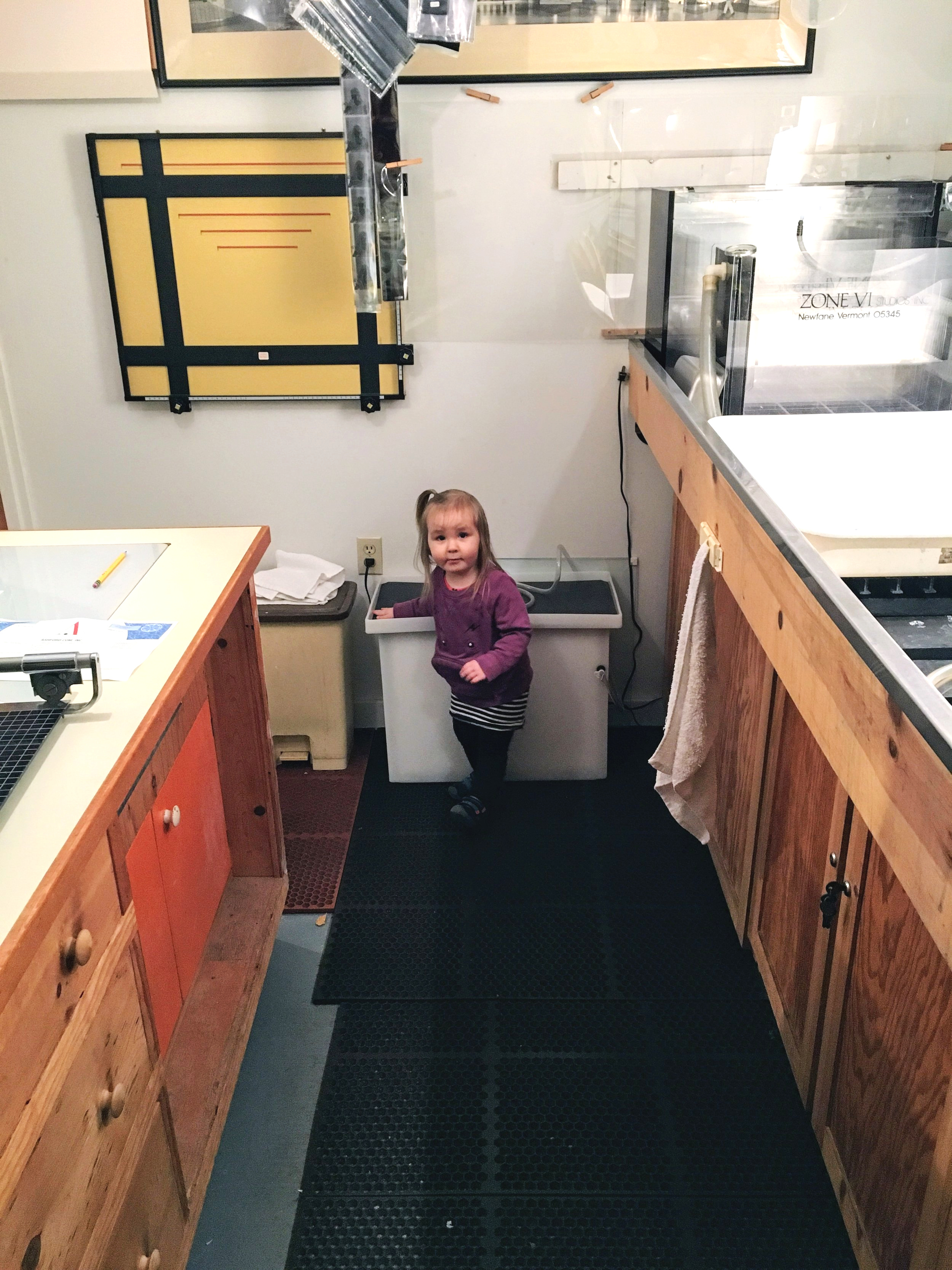Ramona helps with the large format washer in the darkroom