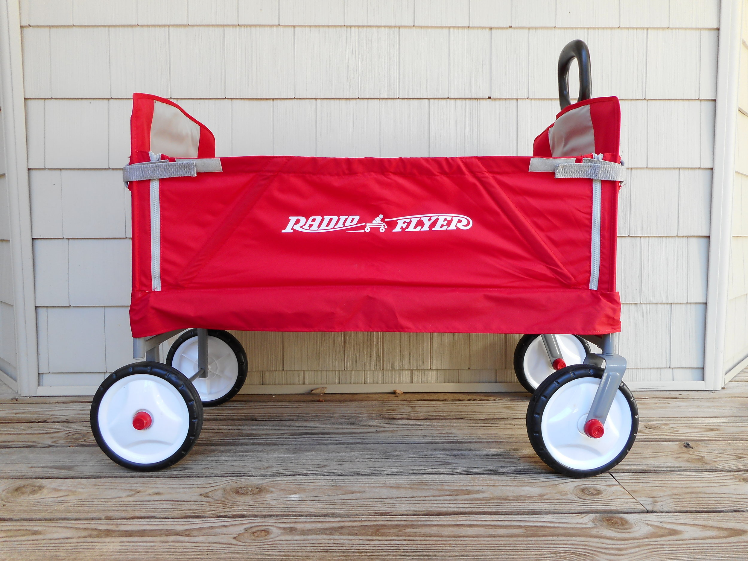 Radio Flyer  Ez Fold Wagon makes outdoor activities less stressful, folds down to a bench, & can carry a tired kiddo for you