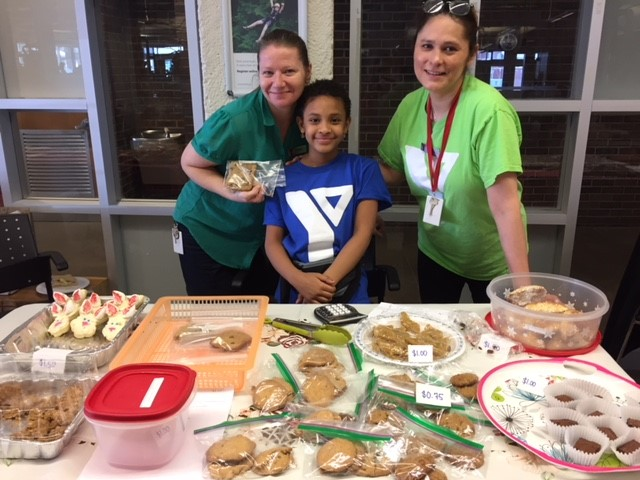 Y Staff members hosting a Bake sale in support of the Y Strong Kids Campaign