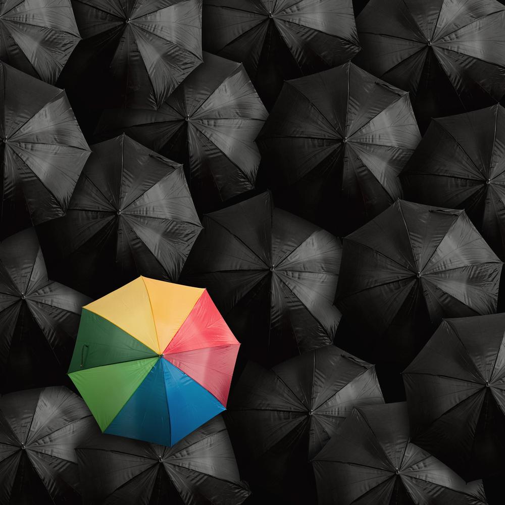 Rainbow umbrella amongst black.jpg