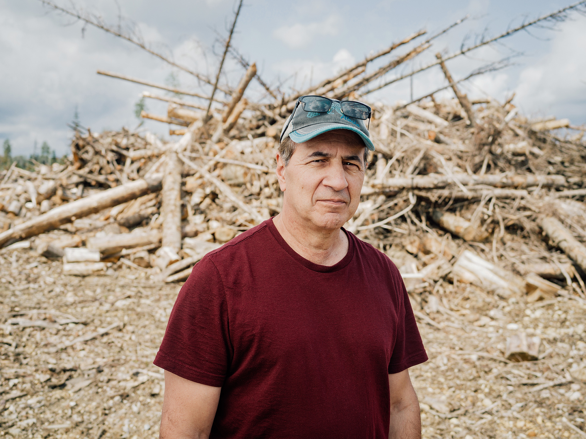 Dominick DellaSala, president and chief scientist at the Geos Institute, in front of a slash pile waiting to be burned in the Anzac River Valley of British Columbia.