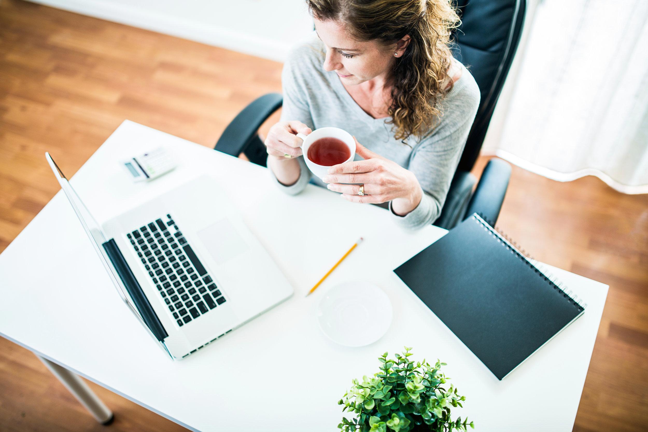 Tech Concierge Executive - enjoying seamless support while enjoying a cup of tea.jpg