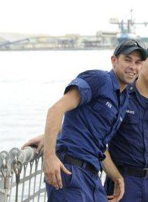 Photo of Tim in the U.S. Coast Guard. Classic smile.