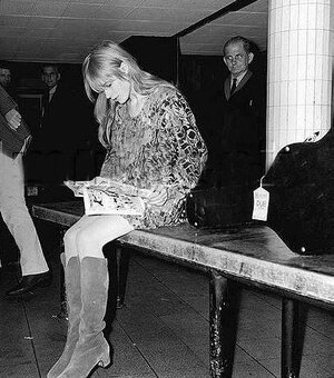 Marianne Faithfull makes me want to steal my mom's tall boots and get caught reading on what appears to be a baggage claim.