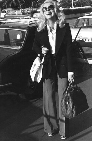 Catherine Deneuve is a patron saint of my personal style. I mean, even schlepping is chic on her.