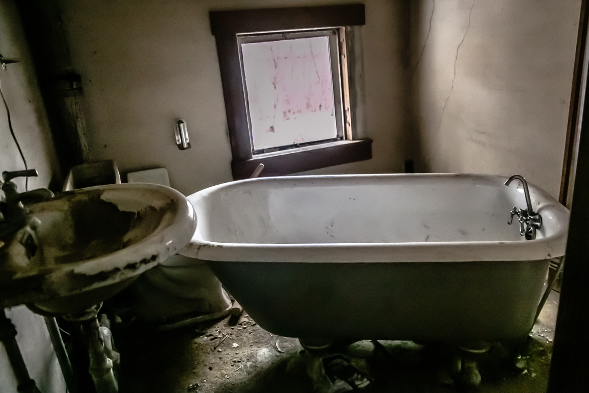 Now  THIS  was exciting. Do you know how long Sam and I have been looking for a real claw foot bathtub in an abandoned place that we could use for a shoot? FOREVER. This has been on our list of ideas for a long time, AND it is not really too dirty at all!