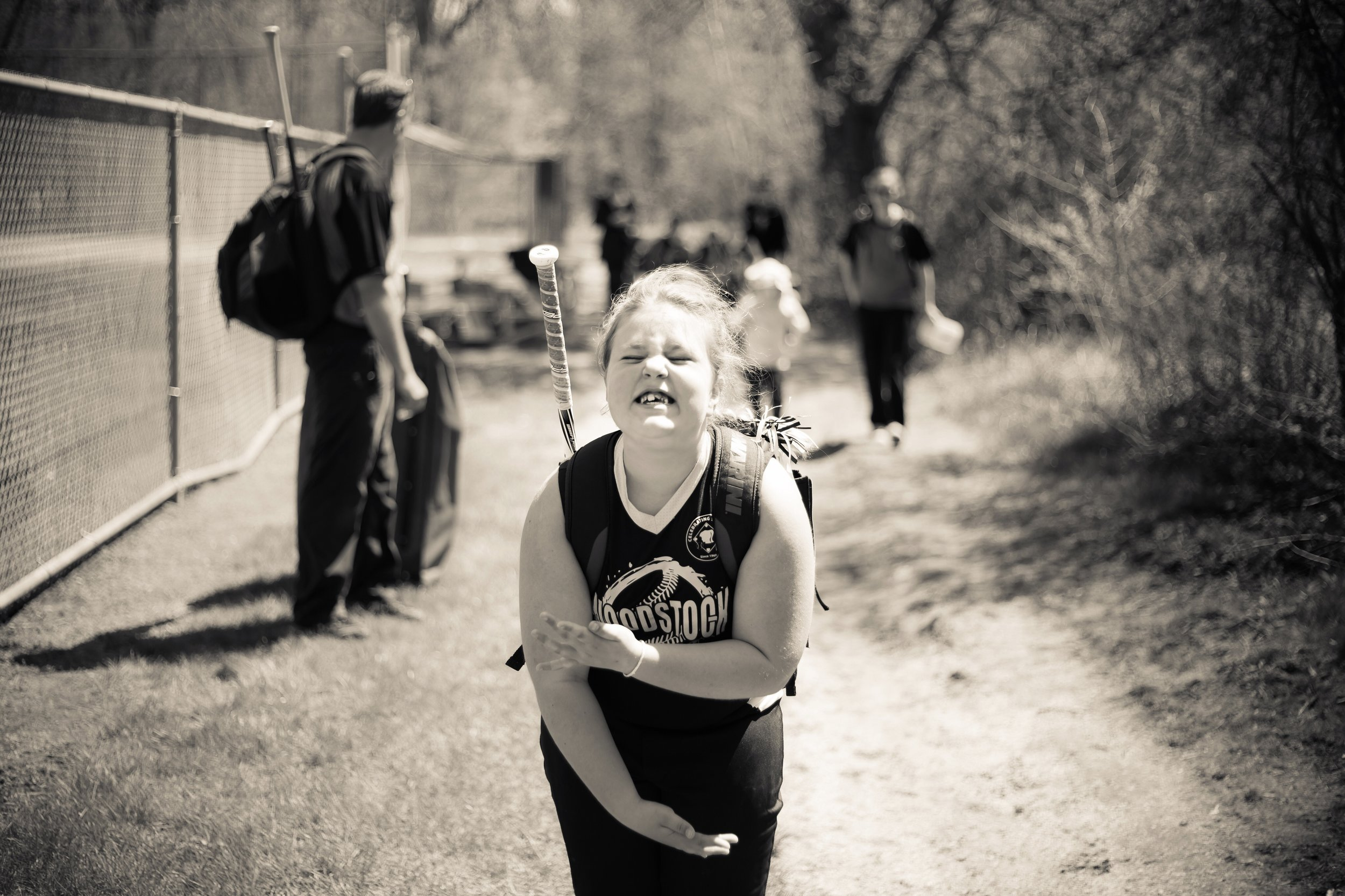 One thing about Quincey: she's super animated. This was shot post-first softball game, and it was all she could do to not dance down the path. Wait. She did. And I just love her.