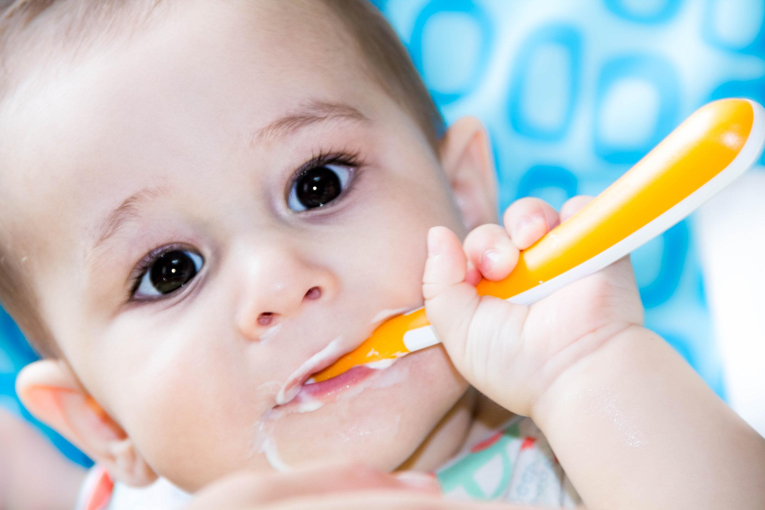 baby eating yogurt .jpg
