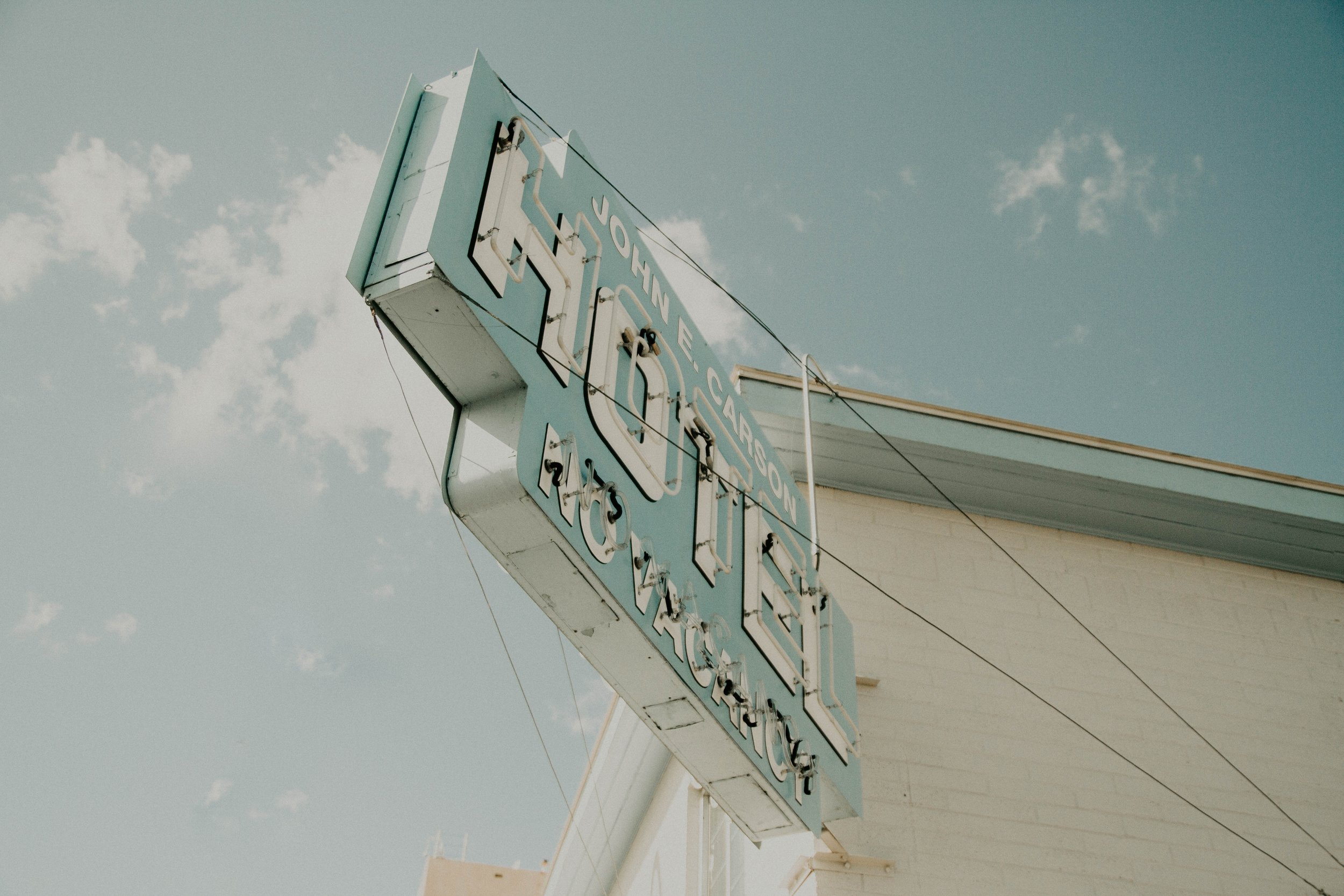 neonbrand-hotel sign-unsplash.jpg