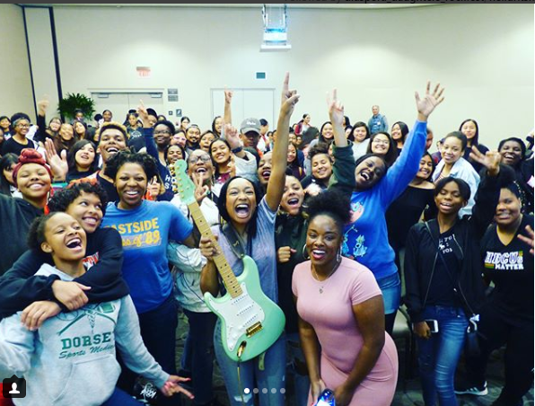 #BLACKGIRLMAGIC: The talented guitarist and artist, Malina Moye, paid our students a visit at our first annual, Future of Feminism Conference. (2018)