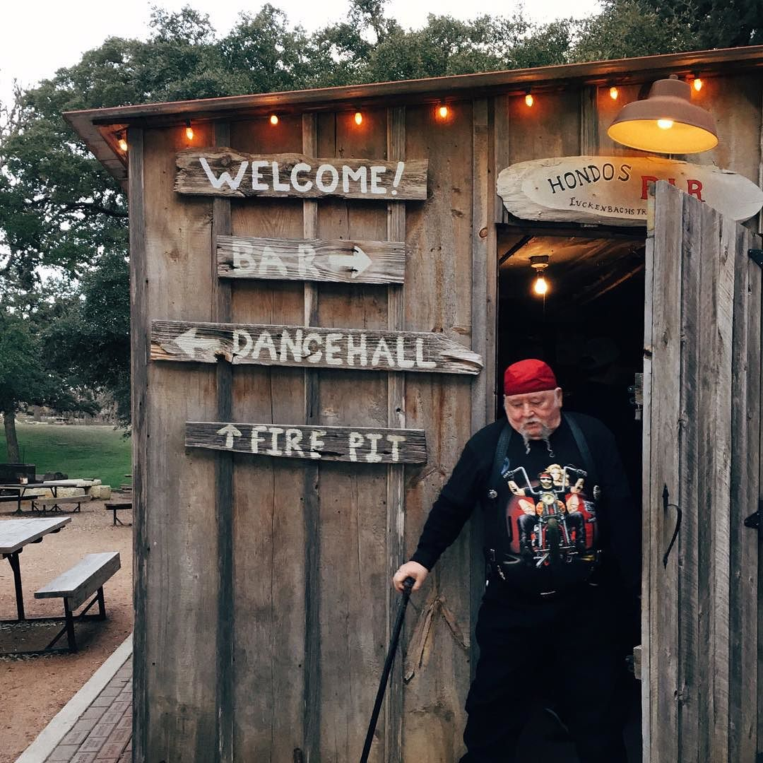 Welcome_to_Luckenbach__Texas__a_3-building_town_with_country_folk__roosters__motorcycles_and_an_old_dancehall._Inside_this_tiny_saloon__a_few_folks_with_guitars_are_huddled_around_a_heater_strumming_farewell_to_the_weekend.__luckenbach__exploreTX.jpg