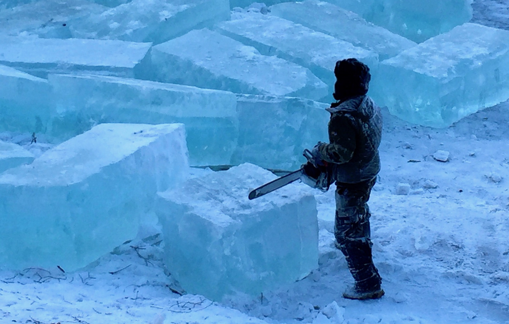 Cutting blocks of ice from which to create ice sculptures