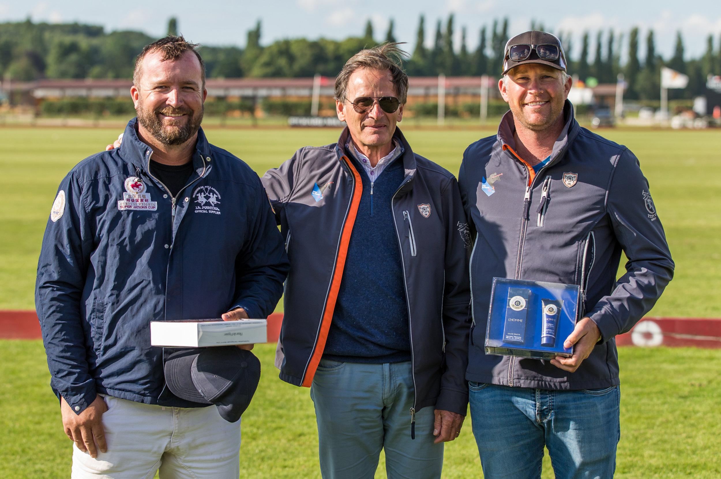 Philippe Perrier, Directeur Général du Polo Club du Domainde de Chantilly, entouré des deux arbitres officiels du club  Philippe Perrier,General Manager of Chantilly Polo Club, with the two offcial club umpires.