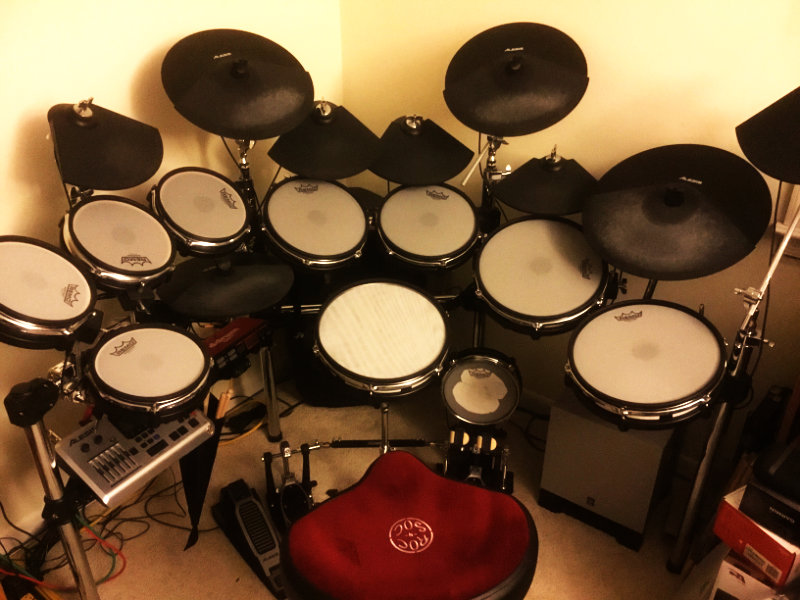 """Sim Series 3Ply Snare - The original kit is an Alesis DM10X kit. I then found & bought a couple 8"""" pads on eBay, and later found someone on Craigslist selling 5 more 8"""" pads and those 4 small triangle shaped cymbal pads. In order to hook everything up, you'll see the Alesis DM10 module as well as a DDrum I/O module (made by Alesis) which gives me a lot more inputs to spare! There's still three 8"""" pads to put somewhere. I'll probably just keep them, as spares. I only wish I realized how much of a difference the heads make before replacing them all with single ply Remo heads. The other heads will get replaced in time as funds permit. :-)Matt P. 4/4/18"""