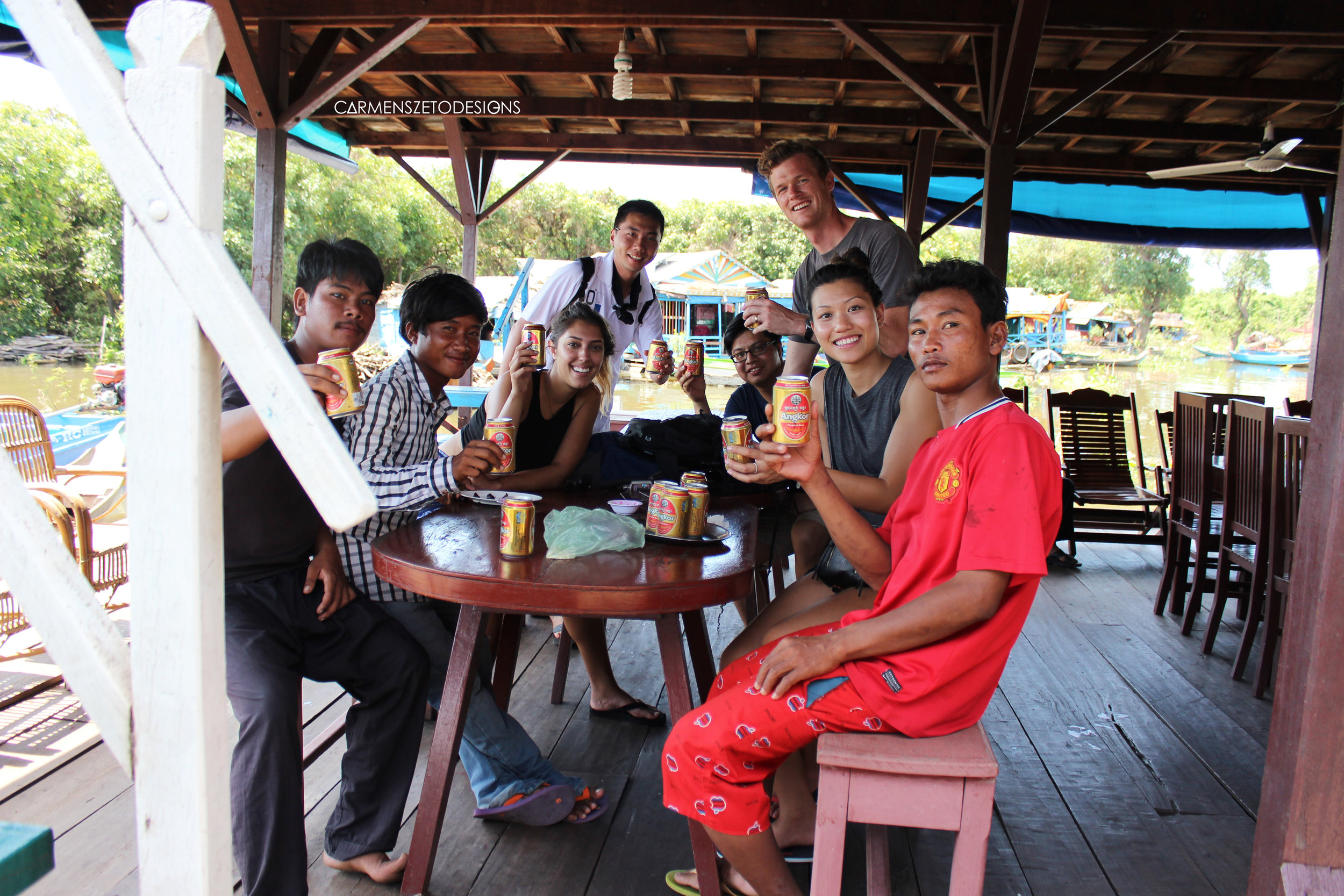 Our local guides at the Tonle Sap floating village and our friends that works with GoPro we met on the same trip enjoying crocodile and beer!