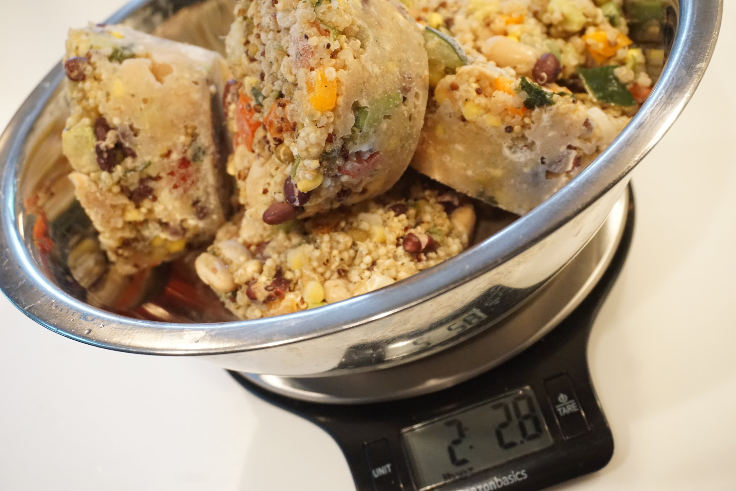 Weighing frozen pucks of quinoa salad