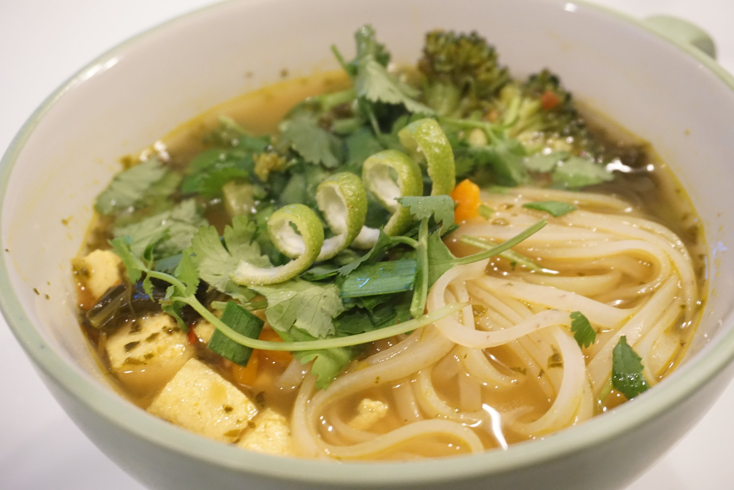 Vegan Lemongrass Soup with broccoli, brown rice noodles, garlic chives, and cilantro