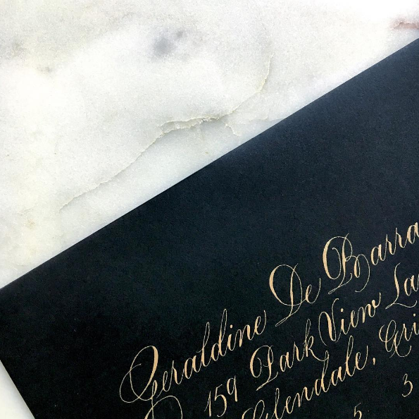 luna gold on black envelope.png