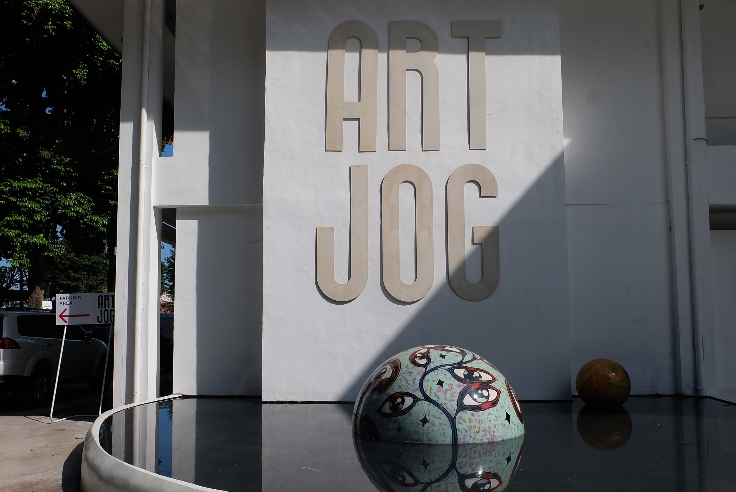 "Entrance to ART JOG;Wedhar Riyadi's ""Floating Eyes Series"", 2017."