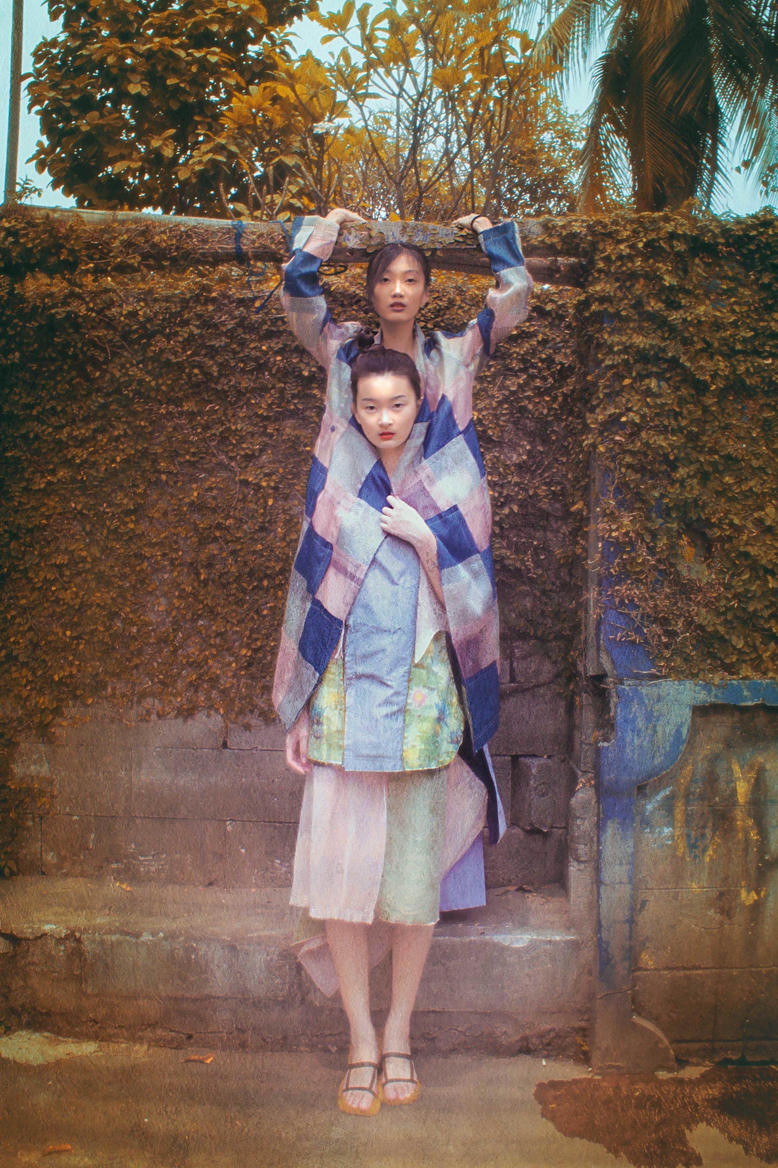 on Zeline: coat by TANGAN, pants by Aesthetic Pleasure  on Clarita: top, skirt, shoes by TANGAN