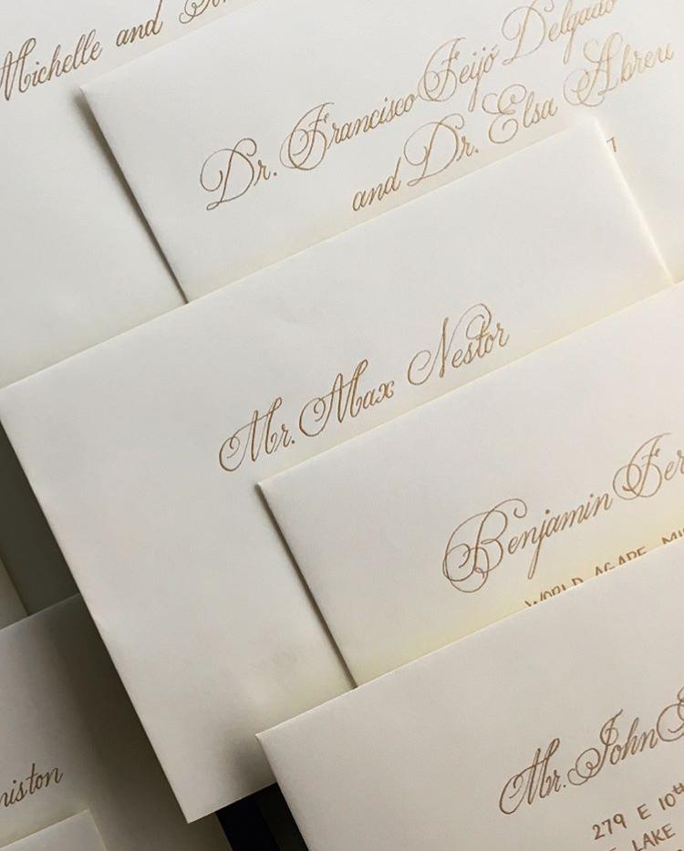 cream and gold wedding envelopes