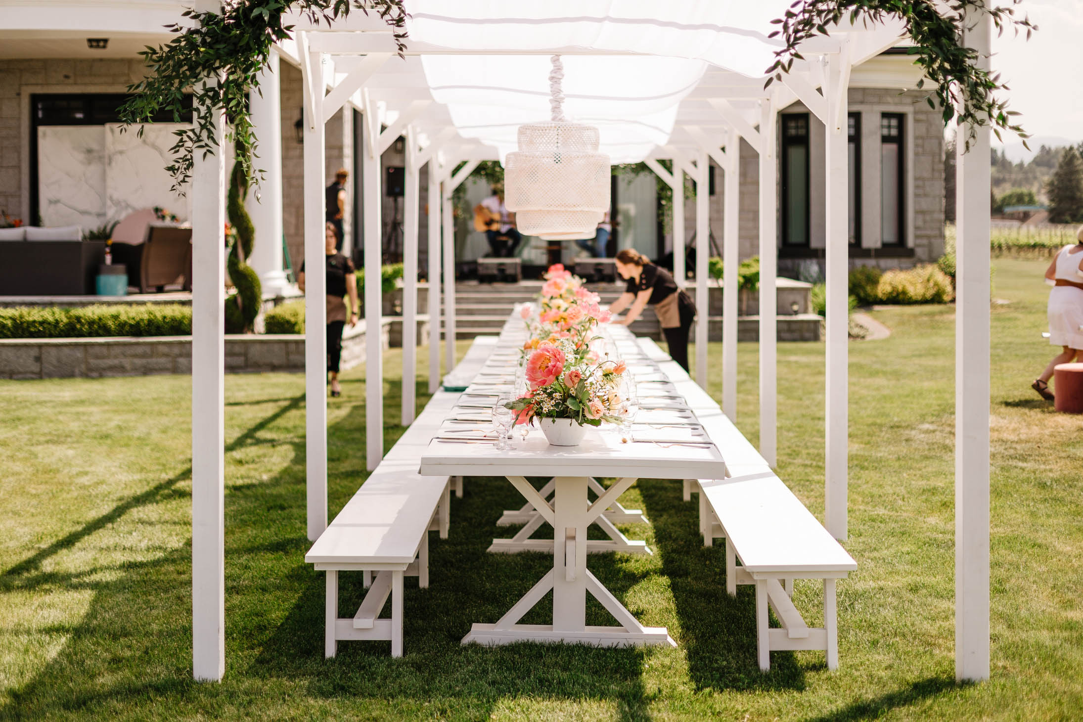 New from Refined Furniture!! - This solid wood white pergola is now ready for renting! We built it custom for a a Mamas for Mamas fundraiser, put on by Jillian Harris. It looks beautiful as-is, but can also be dressed up in any way you wish to fit the decor of your wedding or event.It measures 8 ft wide and then continues on in 8' sections. In this photo we put 5 sections together to make it 40', but it can be rented in 8' increments, up to the maximum of 40'.