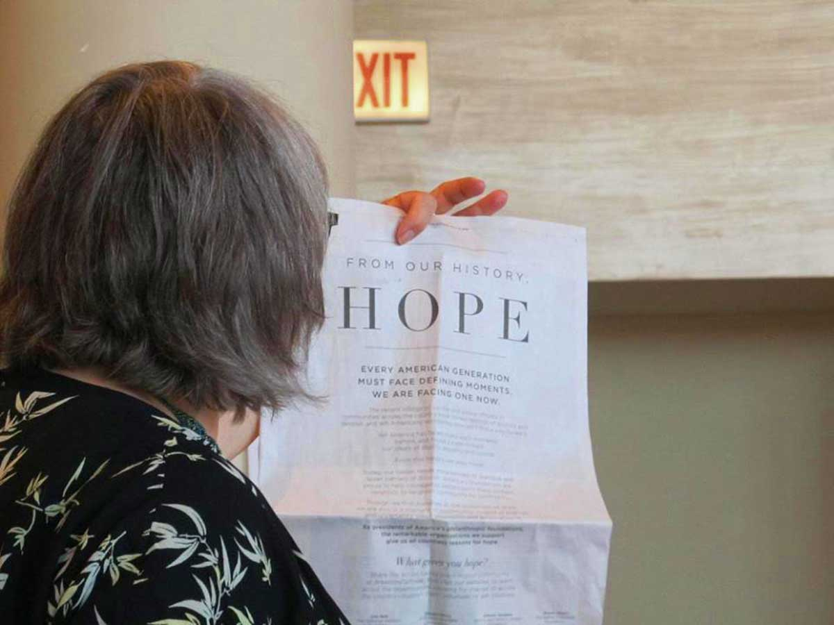awc-mary-lou-holding-hope-newspaper.jpg