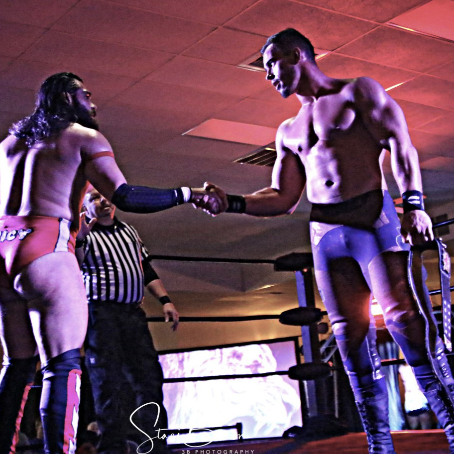 MARCH 10, 2018 - Full Impact Pro Champion Austin Theory (right) is congratulated by Danny Ramons after Theory's successful defense. Ramons and Irish Jack competed for the title. (3B Photography)