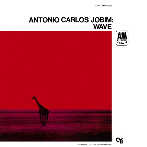 """The infamous """"red giraffe"""" image created by Turner while on assignment in Africa, was used for Antonio Carlos Jobim's  Wave  (1967, A&M Records). Alternate versions feature a green sky and blue field."""