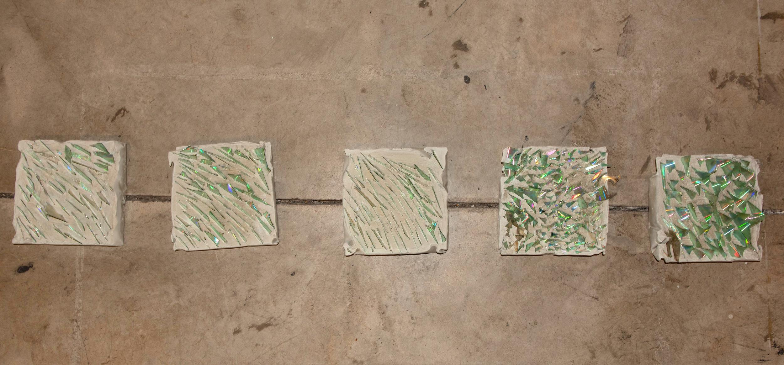 Glass Foot Megan Burchett and Maddie Zerkel Minneapolis, MN Cement with broken CDs 2018 $100 each