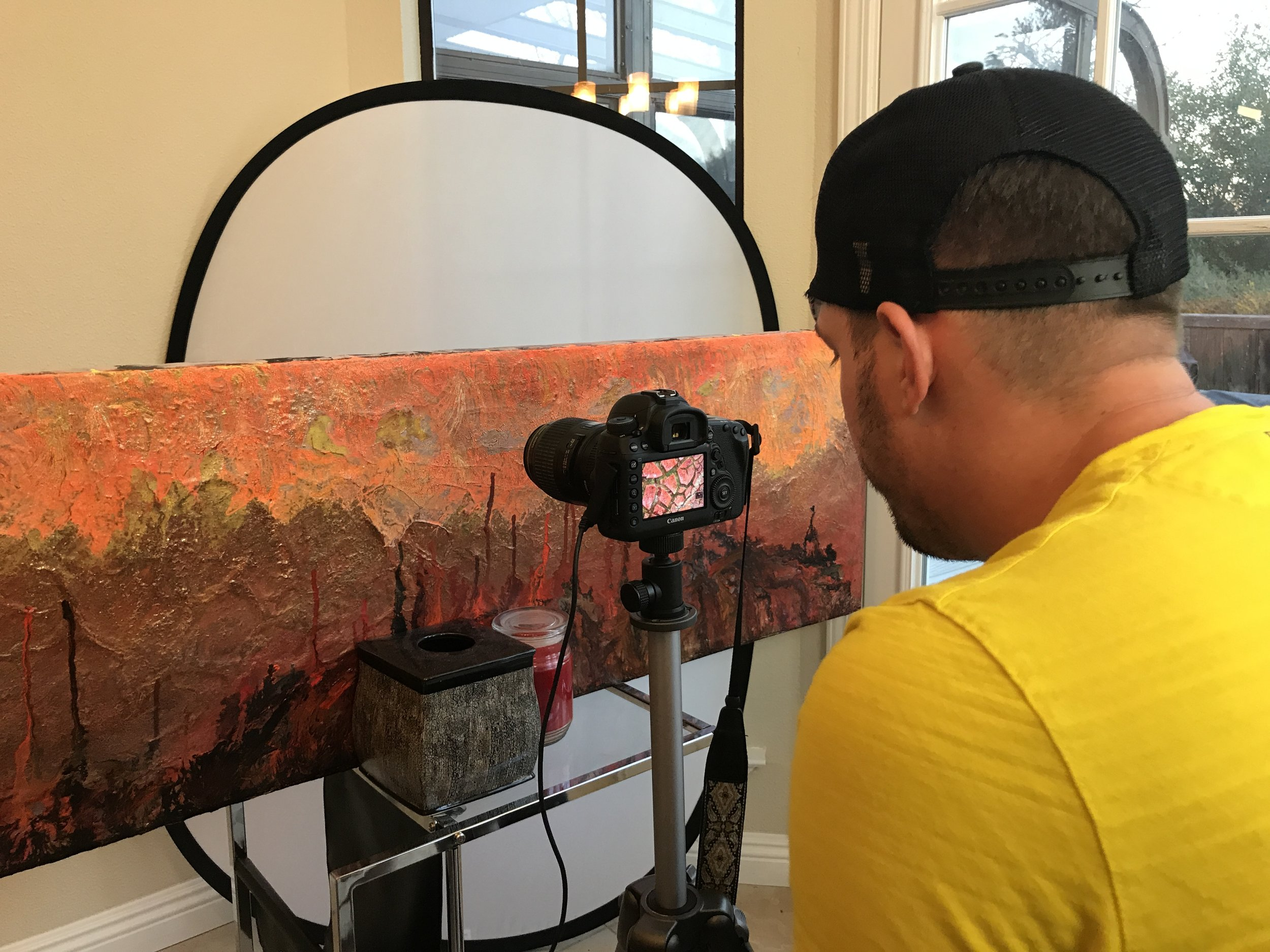 Cameron takes enlarged photos of a fingernail-sized area on his acrylic paintings.