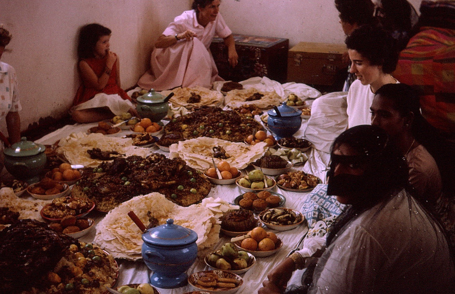 A %22feast%22 at a friend's home. Among others, in the photo are Nancy, Mom, Gertrude, Helen...jpg