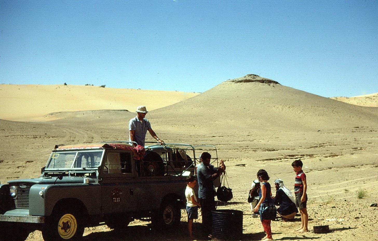 Family on a trek through the sands.jpg