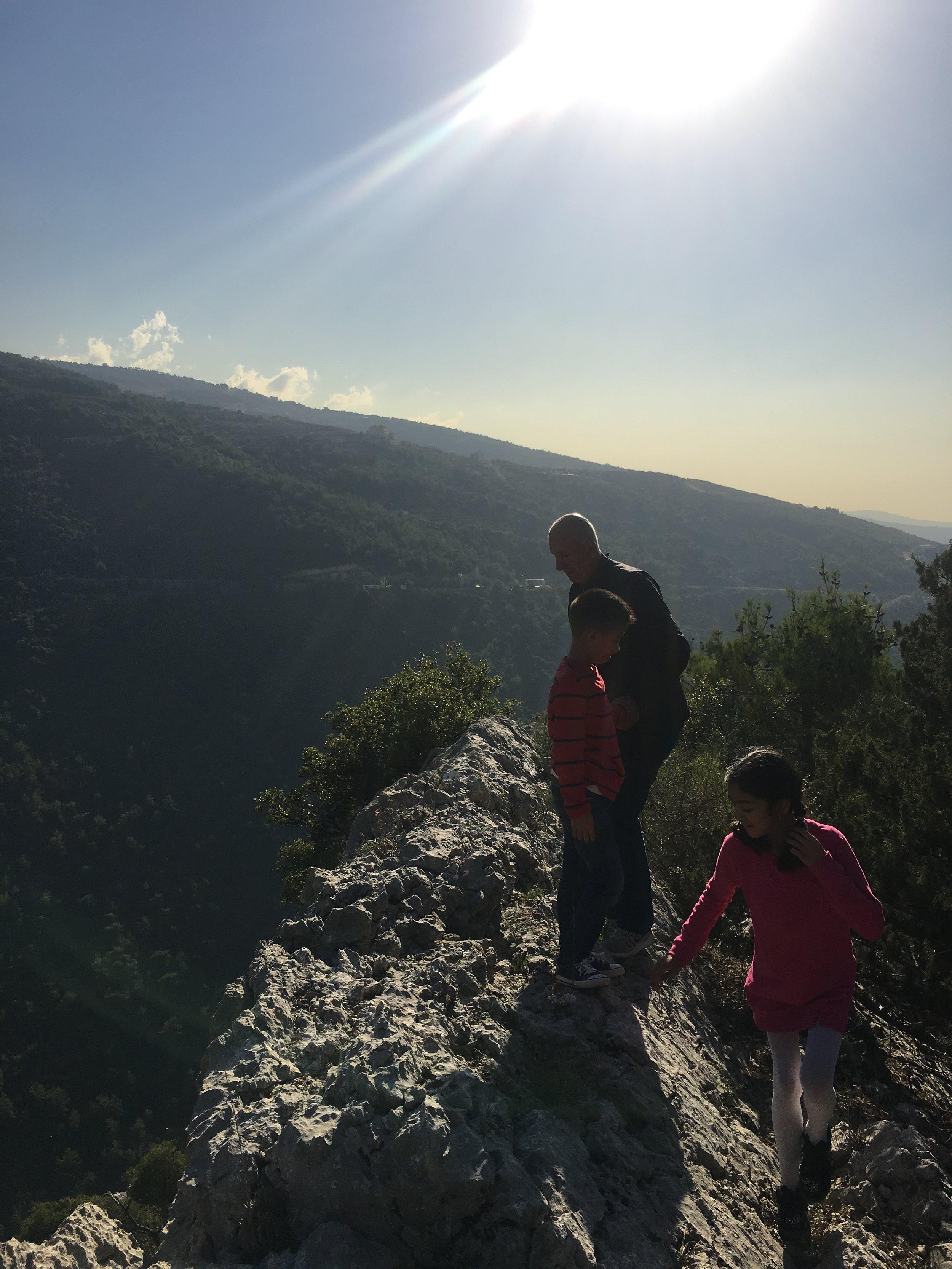 Butros & his children climbing the valley