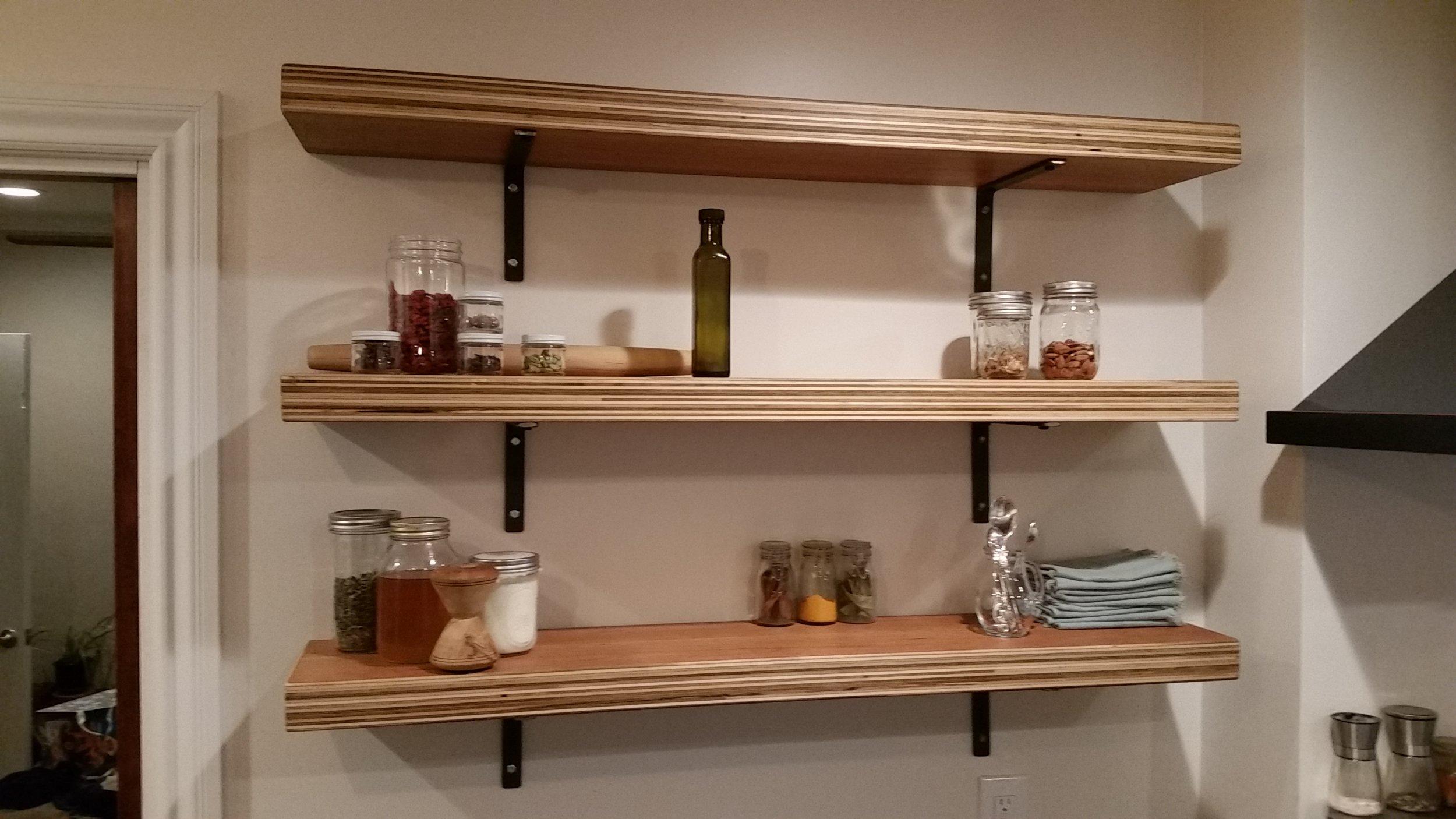 Cherry plywood kitchen shelves.