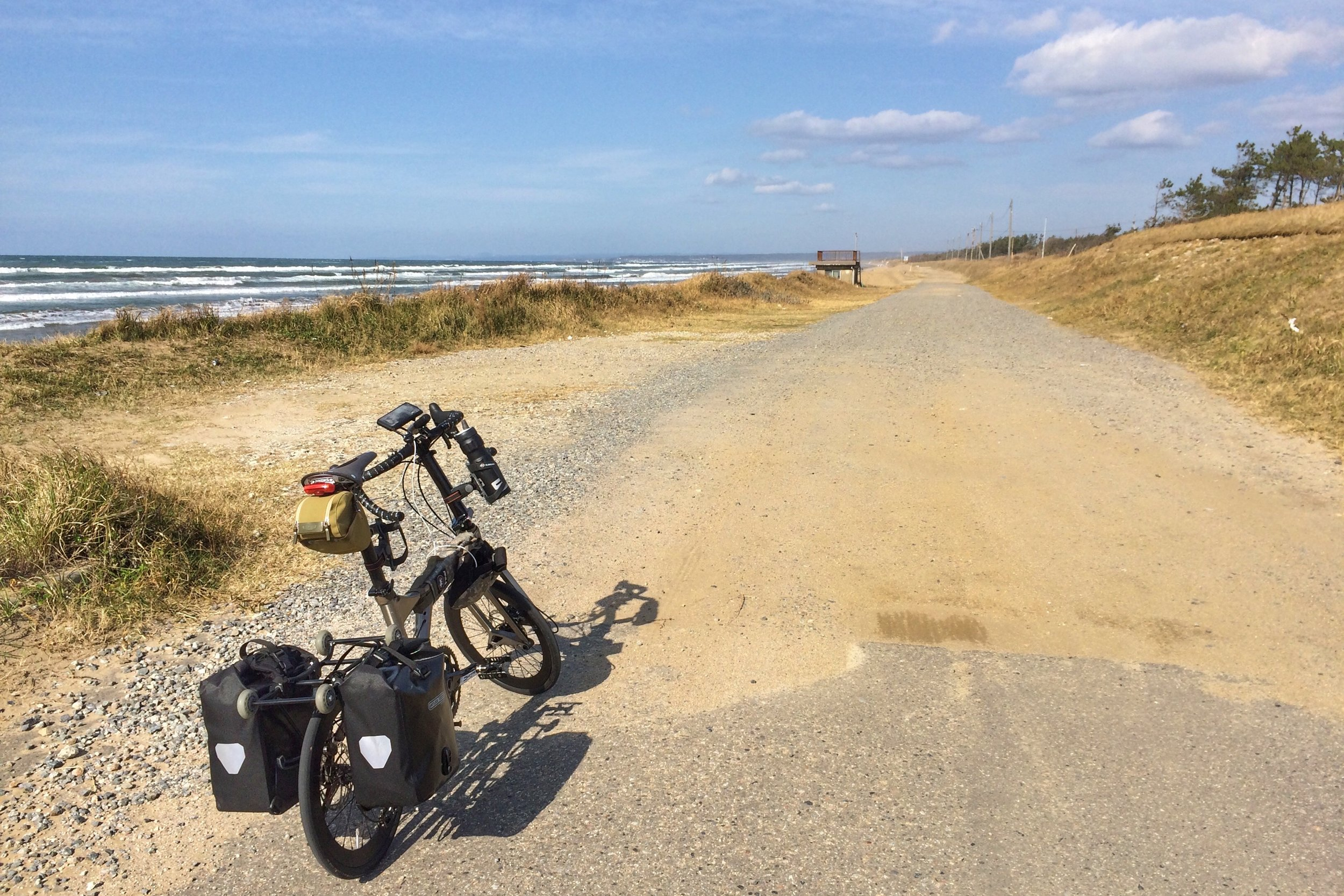 Our starting point at Chirihama with tightly compacted fine sand. It's a challenging ride on skinny tyres.